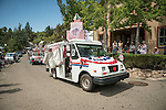 U.S. Post Office delivery vehicles. Downtown main street during the Independence Day celebration Main Street, Mokelumne Hill, California
