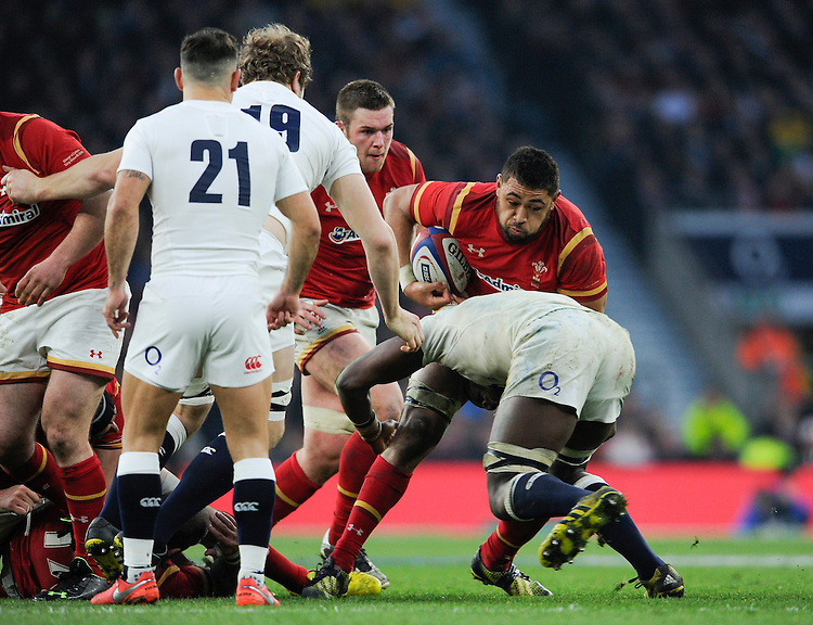Wales' Taulupe Faletau is tackled by England's Maro Itoje<br /> <br /> Photographer Ashley Western/CameraSport<br /> <br /> International Rugby Union - RBS 6 Nations Championships 2016 - England v Wales - Saturday 12th March 2016 - Twickenham - London<br /> &copy; CameraSport - 43 Linden Ave. Countesthorpe. Leicester. England. LE8 5PG - Tel: +44 (0) 116 277 4147 - admin@camerasport.com - www.camerasport.com