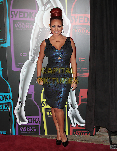 Aubrey O'Day.The Second Annual 'Night of a Billion Reality Stars' Bash held at the Supperclub, Los Angeles, California, USA, 29th March 2012..full length hourglass figure metallic  red hair up in bun blue shiny necklace cut out dress   .CAP/ADM/SLP/JO.©James Orken/Starlitepics/AdMedia/Capital Pictures.