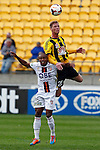 Phoenix's Shaun Timmins, right, gets the height advantage over Perth Glory's Sidnei Sciola Moraes, left, in the A-League football match at Westpac Stadium, Wellington, New Zealand, Sunday, March 09, 2014. Credit: Dean Pemberton