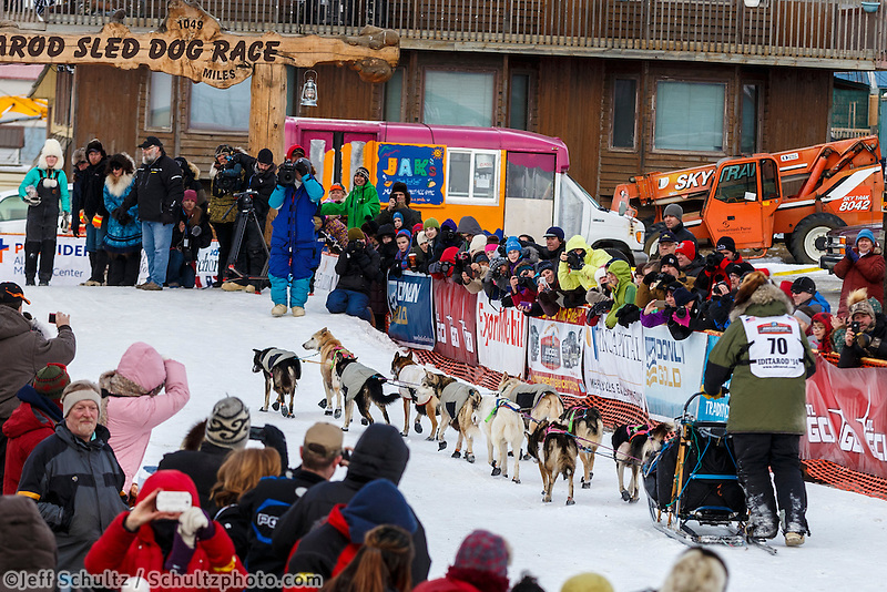 Sonny Lindner runs up the finish chute and under the burl arch in 5th place in Nome on Tuesday March 11th during the 2014 Iditarod Sled Dog Race.<br /> <br /> PHOTO (c) BY JEFF SCHULTZ/IditarodPhotos.com -- REPRODUCTION PROHIBITED WITHOUT PERMISSION