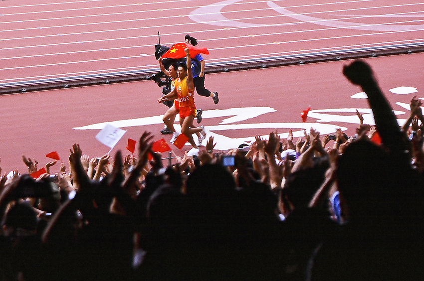 Paralympics Day 3 - Beijing 2008<br /> Gold medal for Wu Chunmiao 100m T11<br /> The chinese paralympic athlete Wu Chunmiao is celebrating her gold medal in the Women's 100m T11 (12.31 seconds) with her guide at the National Stadium. September 9 2008<br /> High resolution available.