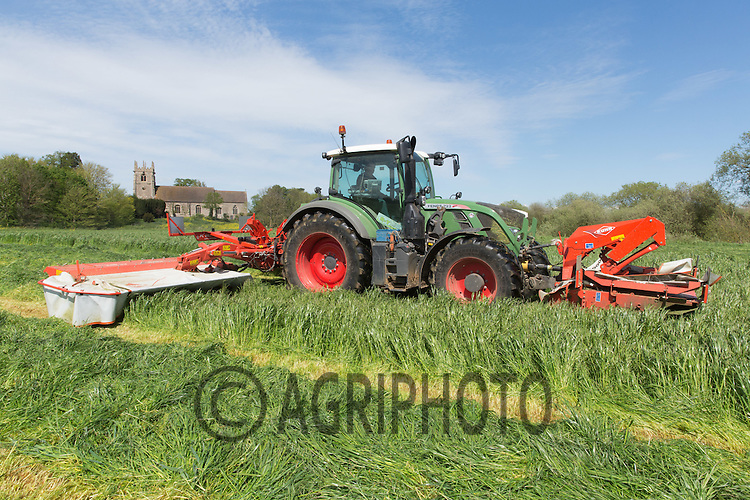 Contractors mowing grass for silage on a Dairy farm<br /> Picture Tim Scrivener 07850 303986