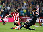 Chris Basham of Sheffield Utd tackles Ben Godfrey of Norwich City during the Premier League match at Bramall Lane, Sheffield. Picture date: 7th March 2020. Picture credit should read: Simon Bellis/Sportimage
