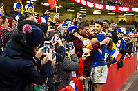 Romain Ntamack of France celebrates with French fans at full time during the Guinness Six Nations Championship Round 3 match between Wales and France at the Principality Stadium in Cardiff, Wales, UK. Saturday 22 February 2020