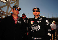 Apr. 1, 2012; Las Vegas, NV, USA: NHRA top fuel dragster driver Shawn Langdon (right) with PR rep Rob Goodwin during the Summitracing.com Nationals at The Strip in Las Vegas. Mandatory Credit: Mark J. Rebilas-