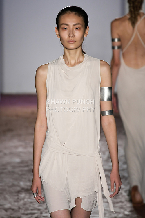Model walks runway in a pale nude delat dress from the Kimberly Ovitz Spring 2013 runway show at Pier 57, during New York Fashion Week on September 6, 2012.