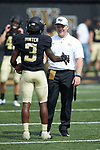 Greg Dortch (3) of the Wake Forest Demon Deacons shakes hands with a student manager prior to the game against the Towson Tigers at BB&T Field on September 8, 2018 in Winston-Salem, North Carolina. The Demon Deacons defeated the Tigers 51-20. (Brian Westerholt/Sports On Film)