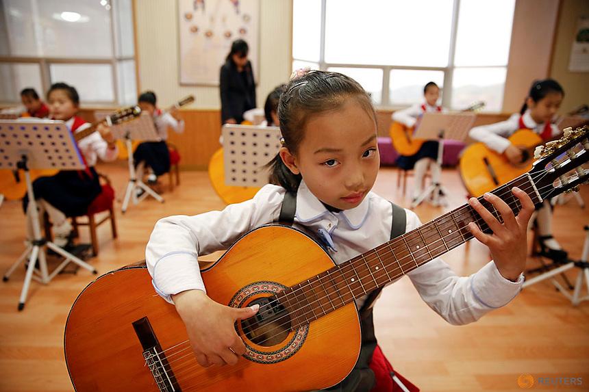 Girls play guitars at the Mangyongdae Children's Palace in central Pyongyang, North Korea May 5, 2016.  REUTERS/Damir Sagolj