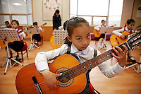 Girls play guitars at the Mangyongdae Children's Palace in central Pyongyang, North Korea May 5, 2016.  REUTERS/Damir Sagolj