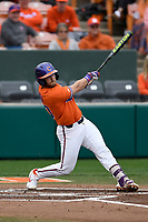 Catcher Kyle Wilkie (10) of the Clemson Tigers bats in a game against the South Alabama Jaguars on Opening Day, Friday, February 15, 2019, at Doug Kingsmore Stadium in Clemson, South Carolina. Clemson won, 6-2. (Tom Priddy/Four Seam Images)