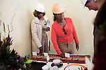"""JOHANNESBURG, SOUTH AFRICA AUGUST 10: Oprah Winfrey inspects the proposed cutlery and kitchen ware with her best friend Gayle King on the site of her school """"Oprah Winfrey Leadership Academy for Girls"""" located about 40 miles south of Johannesburg in Henley-on-Klip, Meyerton. Oprah visited South Africa to interview girls and to inspect the construction of the school. (Photo by Per-Anders Pettersson).."""