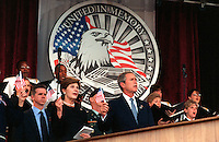 """Oct 11, 2001, Washington, DC, United States<br /> <br /> President George W. Bush and first lady Laura Bush wave the flag and sing """"God Bless America"""" during a memorial service at the Pentagon on Oct. 11, 2001, in honor of those who perished in the terrorist attack on the building.  President Bush, Secretary of Defense Donald H. Rumsfeld and Chairman of the Joint Chiefs of Staff Gen. Richard B. Myers, U.S. Air Force, eulogized the 184 persons killed when a terrorist hijacked airliner was purposely crashed into the southwest face of the building on Sept. 11, 2001 <br /> <br /> Mandatory Credit: Photo by DoD photo by R. D. Ward. (Released)-"""