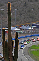 Nov. 9, 2008; Avondale, AZ, USA; NASCAR Sprint Cup Series driver Jimmie Johnson (48) leads a line of cars during the Checker Auto Parts 500 at Phoenix International Raceway. Mandatory Credit: Mark J. Rebilas-
