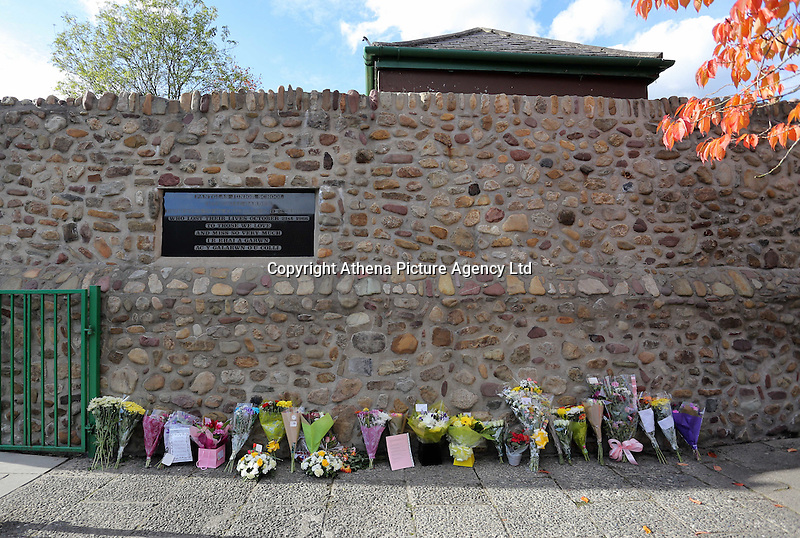 Pictured: Flowers and tributes left at the entrance to the Memorial Garden Friday 21 October 2016<br />