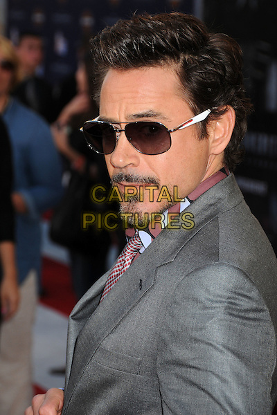 "Robert Downey Jr..Premiere of ""Captain America: The First Avenger"" held at The El Capitan Theatre in Hollywood, California, USA..July 19th, 2011.headshot portrait pink grey gray sunglasses shades goatee facial hair  side.CAP/ADM/BP.©Byron Purvis/AdMedia/Capital Pictures."