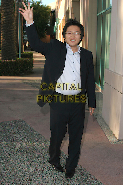 "MASI OKA .The Academy Of Television Arts and Sciences presents An Evening with ""Heroes"" held at ATAS Leonard Goldenson Theater, North Hollywood, California, USA..April 23rd, 2007.full length black suit waving hand gesture .CAP/ADM/CH.©Charles Harris/AdMedia/Capital Pictures"