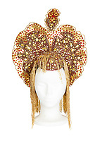"BNPS.co.uk (01202 558833)<br /> Pic:  Julien's/BNPS<br /> <br /> Mae West's custom made heavily embellished gold lamé headdress, est. £1,600.<br /> <br /> A selection of trailblazing 1930s starlet Mae West's most recognisable film costumes have emerged for sale for £320,000. ($400,000)<br /> <br /> The auction features the actress and screenwriter's gowns, headdresses and tiaras, as well as props from her films and her scripts.<br /> <br /> West, a New York native, was the Marilyn Monroe of her era, earning a 'bad girl' reputation for starring in risque productions.<br /> <br /> She famously coined the phrase: ""When I'm good, I'm very good, but when I'm bad, I'm better."""