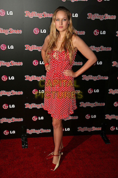 LEELEE SOBIESKI.Rolling Stone Magazine Celebrates the 20th Annual HOT LIST at the Sofitel Hotel's Stone Rose Lounge, Los Angeles, California, USA..October 3rd, 2006.Ref: ADM/BP.full length red white polka dot dress hands on hips.www.capitalpictures.com.sales@capitalpictures.com.©Byron Purvis/AdMedia/Capital Pictures.