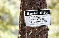 """Burial Site, No Camping, No ATV''s, No Vehicles"" sign posted on tree in Waipio Valley, Big Island, Hawaii"