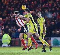 Lincoln City's Ollie Palmer vies for possession with  Cheltenham Town's William Boyle<br /> <br /> Photographer Andrew Vaughan/CameraSport<br /> <br /> The EFL Sky Bet League Two - Lincoln City v Cheltenham Town - Tuesday 13th February 2018 - Sincil Bank - Lincoln<br /> <br /> World Copyright &copy; 2018 CameraSport. All rights reserved. 43 Linden Ave. Countesthorpe. Leicester. England. LE8 5PG - Tel: +44 (0) 116 277 4147 - admin@camerasport.com - www.camerasport.com