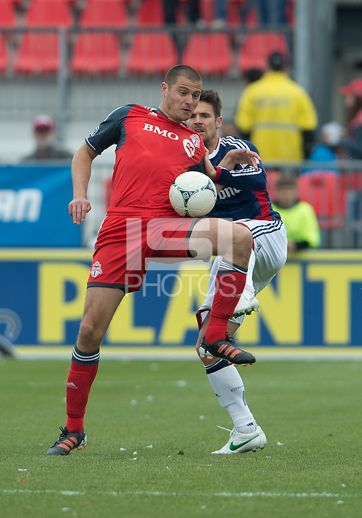 14 April 2012: Toronto FC forward Danny Koevermans #14 and Chivas USA defender Heath Pearce #3 in action during the first half in a game between Chivas USA and Toronto FC at BMO Field in Toronto.