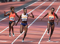 Dina Asher-Smith of GBR crosses the line as she makes a new British 200m record of 10.99 during the Sainsbury's Anniversary Games, Athletics event at the Olympic Park, London, England on 25 July 2015. Photo by Andy Rowland.