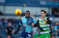 Myles Weston of Wycombe Wanderers holds off Liam Shephard of Yeovil Town during the Sky Bet League 2 match between Wycombe Wanderers and Yeovil Town at Adams Park, High Wycombe, England on 14 January 2017. Photo by Andy Rowland / PRiME Media Images.