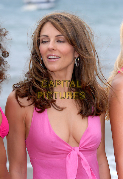 ELIZABETH HURLEY.On Nikki Beach during the 59th International Cannes Film Festival, Cannes, France..May 23, 2006.Ref: FIN.Liz half length pink cleavage.www.capitalpictures.com.sales@capitalpictures.com.© Capital Pictures.