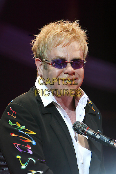 ELTON JOHN.Live at the 02 Arena, London, England..December 13th, 2008.stage concert gig performance music half length black suit sunglasses shades print .CAP/MAR.© Martin Harris/Capital Pictures.