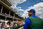 """Jim """"Jim Bob"""" Douglas, who works on the starting crew at Churchill Downs, stops for a moment at the grandstands to take in the enormity of the Kentucky Derby. Start crews work seasonally and are busy during Triple Crown season which includes the Kentucky Derby."""