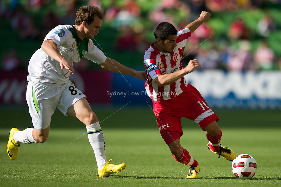 MELBOURNE, AUSTRALIA - January 2:  Adam Casey of the Fury and Aziz Behich of the Heart contest the ball during the round 21 A-League match between Melbourne Heart and North Queensland Fury at AAMI Park on January 2, 2011 in Melbourne, Australia. (Photo by Sydney Low / Asterisk Images)