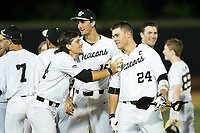 Gavin Sheets (24) of the Wake Forest Demon Deacons is all smiles after his game winning hit in the bottom of the 9th inning against the West Virginia Mountaineers in Game Four of the Winston-Salem Regional in the 2017 College World Series at David F. Couch Ballpark on June 3, 2017 in Winston-Salem, North Carolina.  The Demon Deacons walked-off the Mountaineers 4-3.  (Brian Westerholt/Four Seam Images)