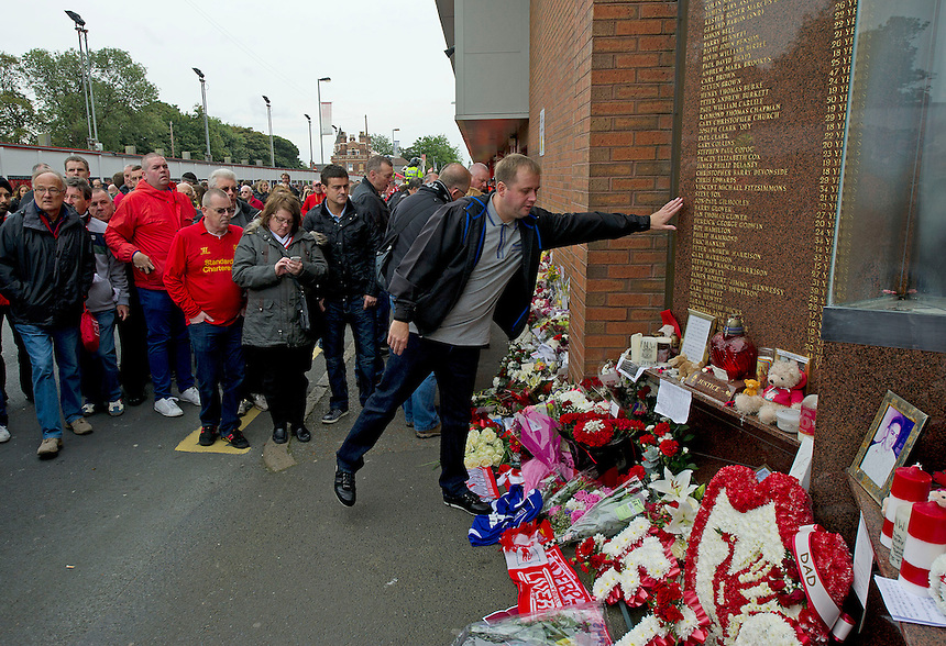 Fans gather at the memorial to the ninety six fans who died at the 1989 Hillsborough disaster outside Anfield, home of Liverpool FC..Football - Barclays Premiership - Liverpool v Manchester United - Sunday 23rd September 2012 - Anfield - Liverpool..