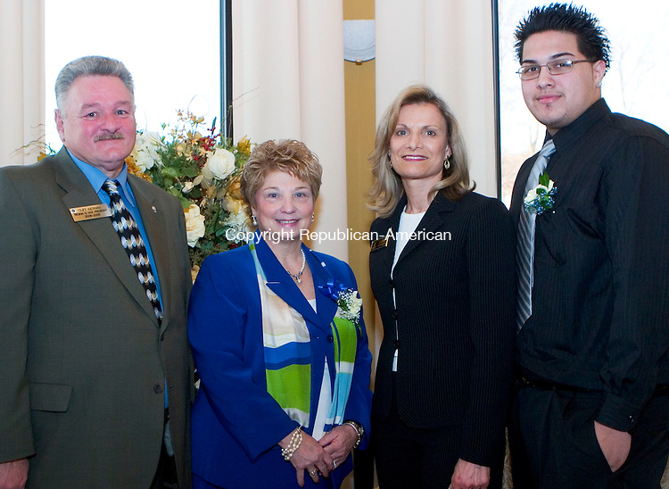 WATERBURY, CT- 27 MARCH 07- 032707JT07- <br /> Exchange Club Region 12 Vice President Cliff Kiernan with Educator of the Year Anne Marie Cullinan, Educator of the Year committee chair Cathy Macdonald, and ACE award recipient Ezequiel Bermudez at the Exchange Club of Waterbury's Awards Night at the Villa Rosa in Waterbury on Tuesday.<br /> Josalee Thrift Republican-American
