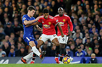 Marcus Rashford of Manchester United tries to shake off a challenge from Chelsea's Andreas Christensen during Chelsea vs Manchester United, Premier League Football at Stamford Bridge on 5th November 2017