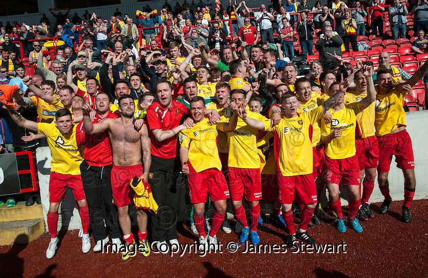 Albion Rovers' players celebrate with the fans at the end of the game after winning the SPFL League Two.