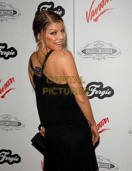 FERGIE - STACEY FERGUSON.Fergie's Birthday Party at Citizen Smith Nightclub in Hollywood, California, USA. .March 28th, 2006.Ref: DVS.Black Eyed Peas half length black dress looking over shoulder.www.capitalpictures.com.sales@capitalpictures.com.Supplied By Capital PIctures