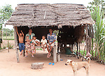 Lo Lina, fourth from left  and his family,  sit together in their house in Kok Thnot Commune village before making the hour long journey to Angkor Children's Hospital in Siem Riep for surgery to repair his cataract