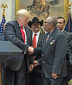 "United States President Donald J. Trump, left, shakes hands with Soul legend Sam Moore of Sam & Dave, right center, prior to signing H.R. 1551, the ""Orrin G. Hatch-Bob Goodlatte Music Modernization Act"" in the Roosevelt Room of the White House in Washington, DC on Thursday, October 11, 2018.  Looking on are John Rich of Big & Rich, left center, and US Representative Darrell Issa (Republican of California), right.<br /> Credit: Ron Sachs / CNP"