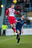 30th November 2019; Dens Park, Dundee, Scotland; Scottish Championship Football, Dundee Football Club versus Queen of the South; Kevin Holt of Queen of the South competes in the air with Josh Todd of Dundee  - Editorial Use