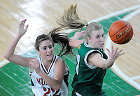 Lynden's Hannah Shine (20) grabs the ball in front of Archbishop Murphy's Sam Pettinger (22) during the 2A Washington State Girls Basketball Championship game at the Yakima SunDome on Saturday, March 14, 2009. Lynden won, 48-41, to become the state champions.