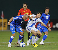 El Salvador midfielder  Denis Alas (14) shields the ball against Guatemalan midfielder Marco Pappa (10)   The Guatemalan National Team defeated  El Salvador National Team 2-0 in a friendly international at RFK Stadium, Saturday September 7, 2010.