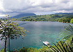The Lembeh Strait is blue and green in the morning sun, looking towards North Sulawesi from Lembeh Island.