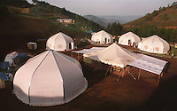 Dome-shaped temporary structures mark the location of  the AmeriCares clinic in Buranga, Rwanda, October 1994. The New Canaan Connecticut humanitarian organization set up their clinic on the road between Goma, Zaire (now Congo) and Kigali, Rwanda to help refugees returning from the camps in Goma and the people living in the area whose illnesses resulted from the destruction of what little infracstracture existed before civil war. (photo Rick D'Elia)