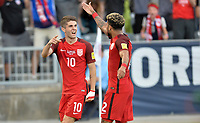 Commerce City, CO - Thursday June 08, 2017: Christian Pulisic and DeAndre Yedlin celebrate a Pulisic goal during their 2018 FIFA World Cup Qualifying Final Round match versus Trinidad & Tobago at Dick's Sporting Goods Park.