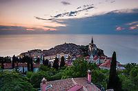Piran, Slovenia at sunset, and the Mediterranean Sea, seen from Piran Town Walls, Slovenian Istria, Slovenia, Europe