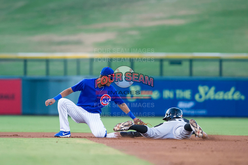 AZL Cubs shortstop Luis Vazquez (1) applies a late tag to Ramon Beltre of the AZL White Sox on August 13, 2017 at Sloan Park in Mesa, Arizona. AZL White Sox defeated the AZL Cubs 7-4. (Zachary Lucy/Four Seam Images)