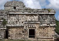 The Monastery, seceral mask of Chaac, God of the rain, at the corners and on the façade, symbol of the corn (¤) above the masks of Chaac on the frieze, Lattice Work, Puuc Architecture, 750-900 AD, Chichen Itza, Yucatan, Mexico. Picture by Manuel Cohen