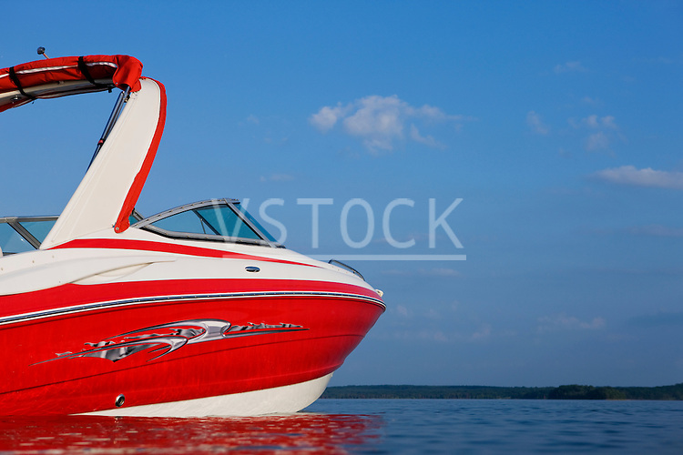 USA, Missouri, Stockton, Stockton Lake, red motorboat on lake